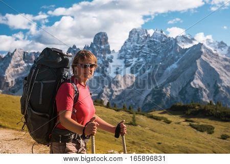 hiker in front of Alps mountains, Dolomites, Italy