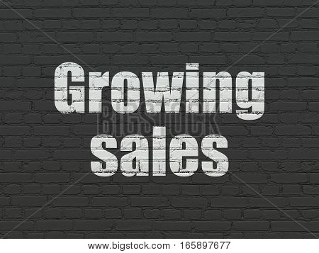Business concept: Painted white text Growing Sales on Black Brick wall background