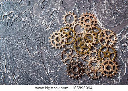 concept hour metal gears on dark background top view.