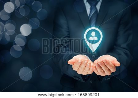 Target customer, customer care and human resources (HR) concept. Businessman hold target customer, employee (or another business person) in hand.