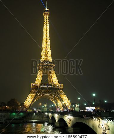 The Eiffel Tower in Paris is illuminated every evening and is a popular place for tourists to visit, Paris, France, December 2016