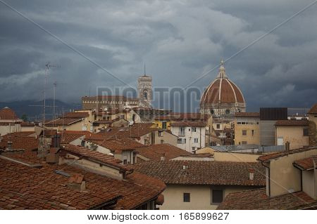 Italy Florence - November 06 2016: view of red roofs Florence Cathedral Dome Giotto's Campanile on November 06 2015 in Florence Italy.
