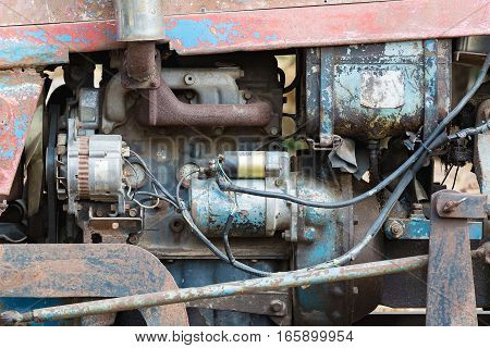 Vintage engine car system. Part of old diesel engine of heavy truck closeup grunge rusty and oil dirty.