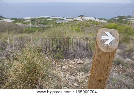 Hiking sign at trekking path over Nerja Caves Mountain. Overlooking Town of Nerja Malaga Spain
