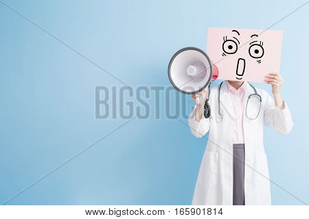 woman doctor take surprise billboard and microphone isolated on blue backgroundasian