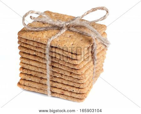 Biscuits tied with string isolated on white background