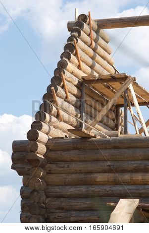 Top section of wooden house construction from timber