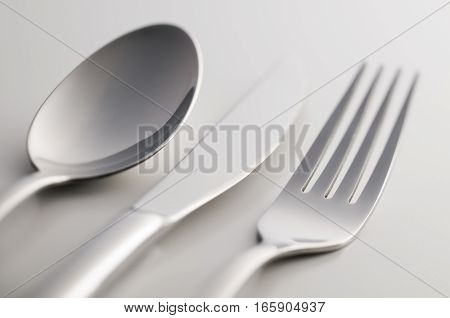 Silverware: fork knife and spoon on white background