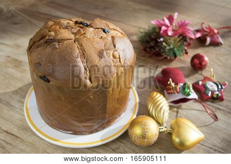 Italian panettone or Italian Christmas cake with ornaments and festoons