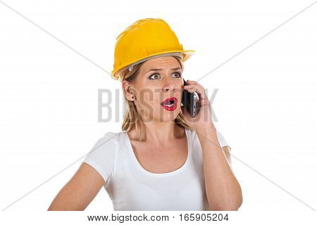 Picture of a surprised female engineer talking on the phone