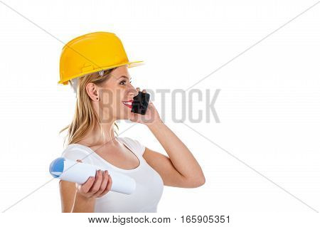 Picture of a beautiful female engineer talking on the phone