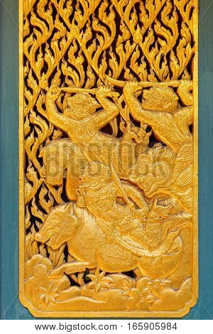 Bangkok, Thailand - December 30 2015: Thai traditional wood carving with gold plated decorated at Phra Kaew Pavilion in Thailand