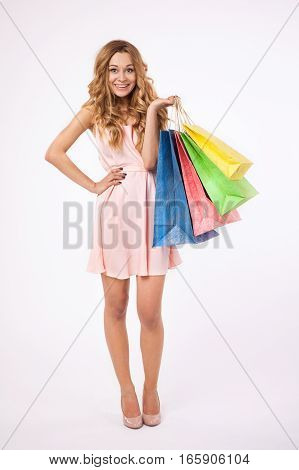 Happy young woman shopping. Young girl holding shopping bags