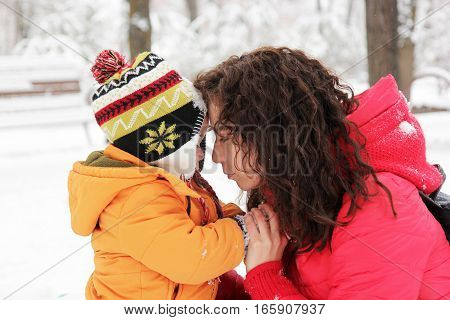Mother And Son Looking At Each Other In Winter Park