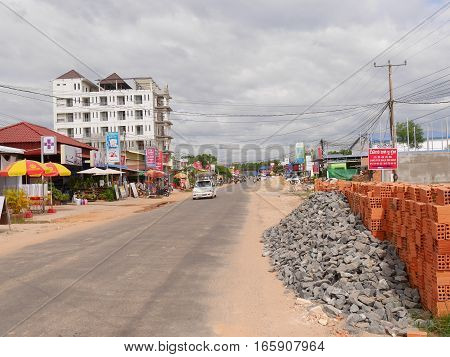 30 december 2016 otres beach sihanoukville cambodia main street of small village otres beach sihanoukville with a car and construction sites visible editorial image