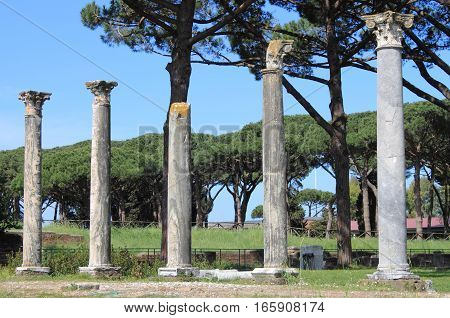 Columns of an ancient roman temple in Ostia Antica the old harbour of Rome, Italy