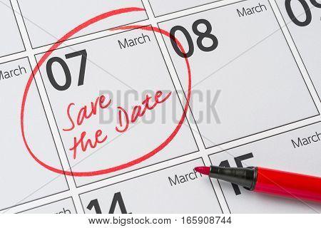 Save The Date Written On A Calendar - March 07