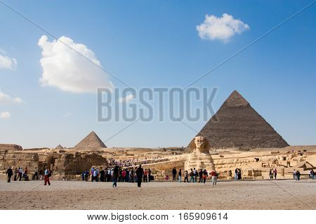 The Great Pyramid and Great Sphinx at Giza Plateau on the background of clouds