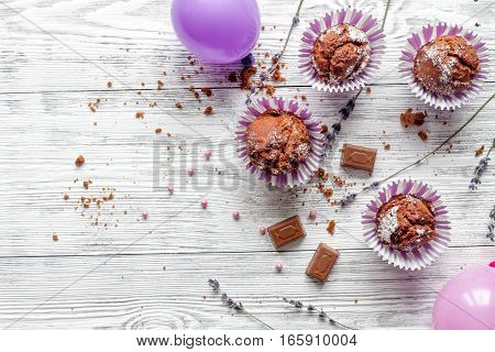 concept of Valentine's Day cupcakes on wooden background top view.