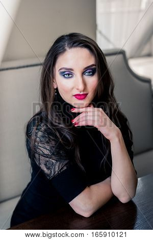 Portrait of a beautiful girl with long hair and makeup
