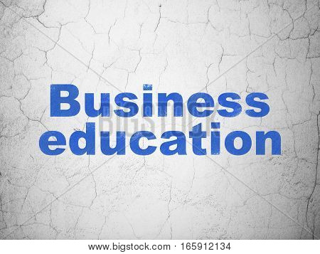 Studying concept: Blue Business Education on textured concrete wall background