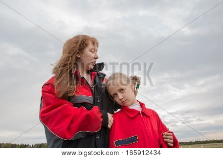 Mother And Daughter Outdoor And Cloudy Sky