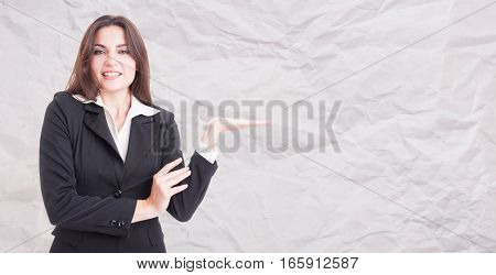 Young Beautiful Businesswoman Holding Something In Her Palm