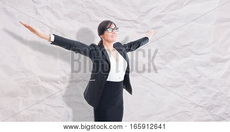 Businesswoman With Arms Raised Outstretched