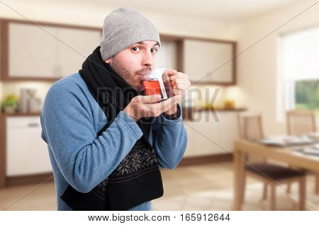 Attractive Man Is Drinking A Warm Tea