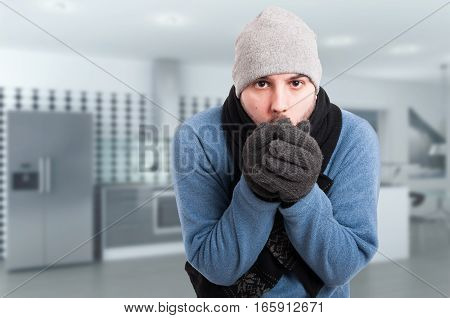 Young Man Trying To Warm His Hands