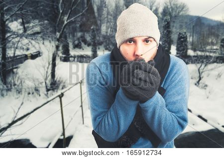 Handsome Man Sitting Outside And Freezing