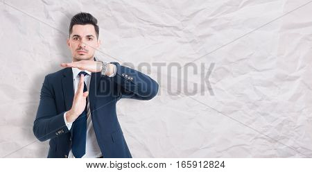 Serious Businessman Showing Time Out Sign