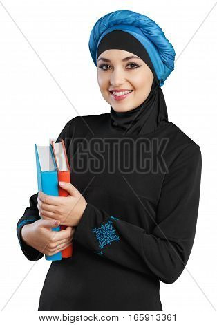 Young muslim woman holding a couple of books