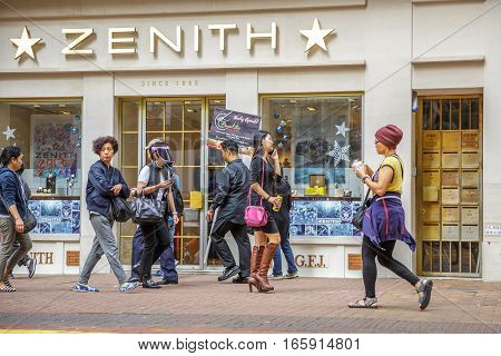 Hong Kong, China - December 6, 2016: Causeway Bay is one of the most attractive areas for tourists and business people and good for shopping. Asian common people in front of famous Zenith watch store.