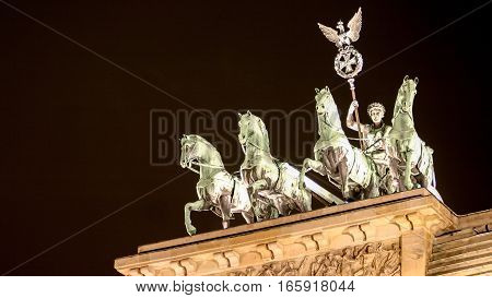 The Brandenburg Gate in Berlin Germany with the famous quadriga visible on top.