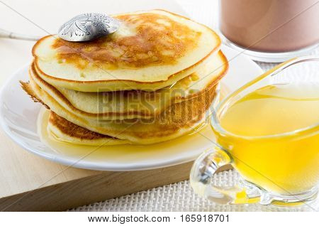 Russian Pancakes With Honey And Vintage Silver Spoon