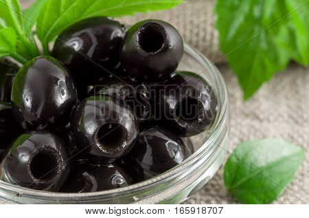 Black Olives, Pitted Marinated In A Glass Bowl