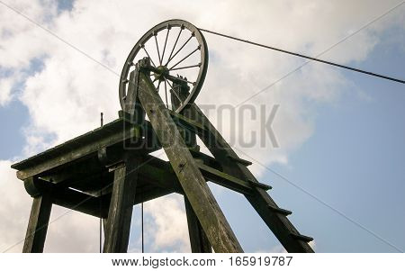 An old Victorian mining wheel at the head of a now disused coal mine in Wales UK.