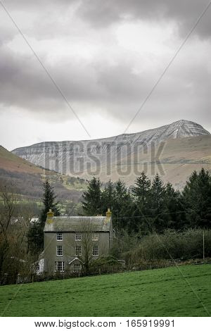 A Welsh farm house nestling in a valley deep in the Brecon Beacons, Wales, UK.