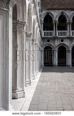 Columns in the courtyard of the Doge's Palace a popular Venetian tourist attraction found in St. Mark's square.