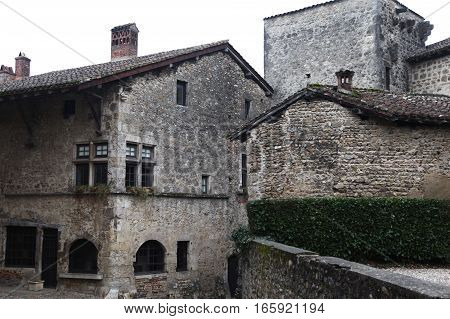 Stone houses with a tiled roof in the medieval village (commune) near Lyon. The place where the historic shoot movies. Paruzhes, France