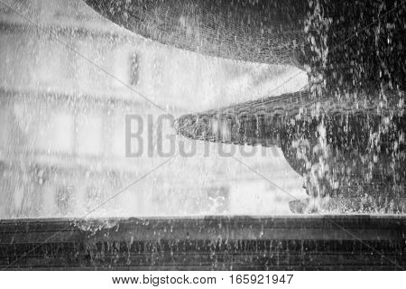 Detail of water falling from one of the large fountains found in London's Trafalgar Square.
