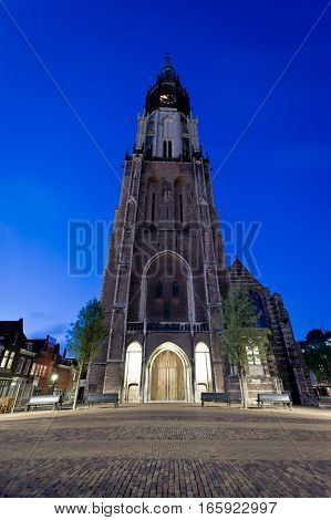 A low angle dusk view of the Nieuwe Kerk the dominant building in Delft market square Holland.