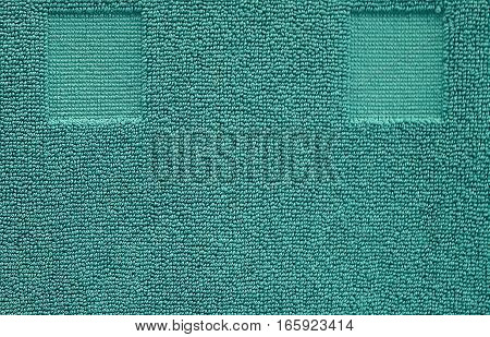 Fabric and Textile Close Up of Blue Green or Teal Cotton Towel or Terry Texture Background with Copy Space for Text Decoration.