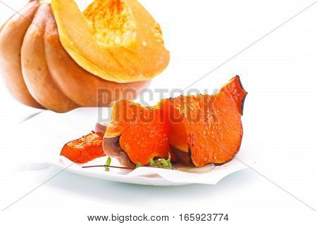 sweet baked pumpkin with honey on a white background
