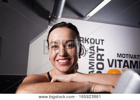 Portrait of young beautiful smiling girl in the gym.
