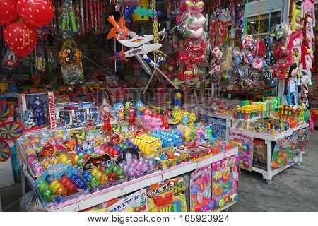 Huge Variety Of Colorful Toys Being Sold At A Roadside Stall