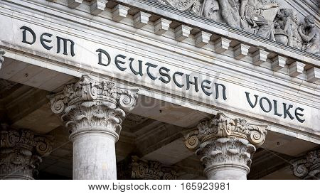 The Reichstag, Berlin, Germany. The dedication on the face of the German parliament building reads
