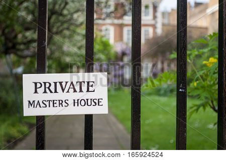 A sign indicating privacy for a Masters House in London's Temple Bar legal district. The masters make up a governing council within the legal community of the area.