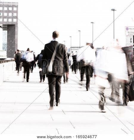 Long exposure high key abstract captures of anonymous London City workers on their way to the office. Intentional creative motion blur to indicate movement.